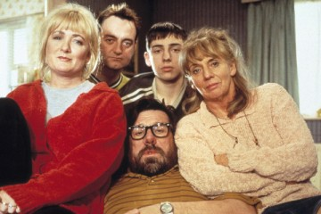 The Royle family pose on their famous sofa