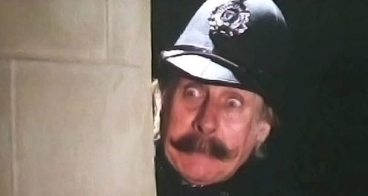 spikle milligan poses as a policeman for his BBC TV series 'Q'
