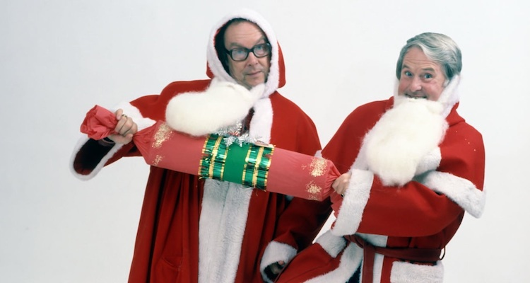 Eric and ernie don santa suits to promote their christmas specials